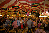 People party inside Stadel beer tent during Kulmbacher Bierwoche beer festival, Kulmbach, Franconia, Bavaria, Germany