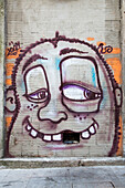 Graffiti on wall with hole in teeth, Porto, Norte, Portugal