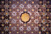 Mudejar tiles with Moorish geometric patterns  on wall of Alcazar, Seville, Andalusia, Spain