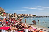 People relax at Mondello beach on a sunny Sunday morning, Mondello, near Palermo, Sicily, Italy