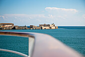 Railing of cruise ship MS Deutschland (Reederei Peter Deilmann) and Castello Maniace citadel and castle, Syracuse, Sicily, Italy