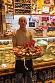 Waiter with absolutely delicious antipasti platter at Fratelli Burgio delicatessen shop and restaurant, Syracuse, Sicily, Italy