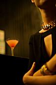 Woman sitting alone at night club bar