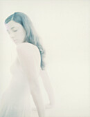 Woman with eyes closed, defocused and overexposed