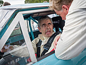 Actor Rowan Atkinson, Mr. Bean, Ford Falcon Sprint, Shelby Cup, Goodwood Revival 2014, Racing Sport, Classic Car, Goodwood, Chichester, Sussex, England, Great Britain