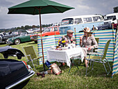 Picnic lunch in the visitor parking area, Goodwood Revival 2014, Racing Sport, Classic Car, Goodwood, Chichester, Sussex, England, Great Britain