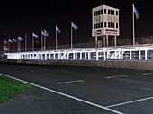 Start- finishing straight and pits at night, 72nd Members Meeting, racing, car racing, classic car, Chichester, Sussex, United Kingdom, Great Britain