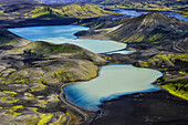 Aerial view of two lakes being fed by glacial river Tungnaa, high-voltage powerline between them, Veidivotn, Highlands, South Iceland, Iceland, Europe