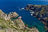 excursion boat cruising into a bay at Cap de Creus (Cabo de Creus),  nature park, most eastern point of Spain, Mediterranean Sea, Costa Brava, Catalonia, Spain