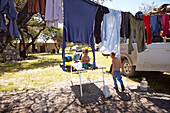 Boys playing in a camp under a clothes line, Otavi, Etoscha, Namibia