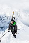 Ski mountaineer ascending via ferrata, Alpspitz, Garmisch-Partenkirchen, Upper Bavaria, Germany