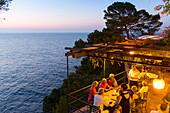 restaurant Nautilus at sunset, guests having dinner, Mediterranean Sea, Port de Soller, Serra de Tramuntana, Majorca, Balearic Islands, Spain, Europe