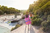 tourist with air mattress at the beach, Cala Sa Nau, Mediterranean Sea, near Portocolom, Majorca, Balearic Islands, Spain, Europe