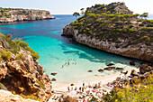 tourists on the beach, bay with turquoise blue sea, near Calo des Moro, Mediterranean Sea, near Santanyi, Majorca, Balearic Islands, Spain, Europe