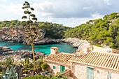 Small house in a bay with turquoise blue sea, Cala s'Almunia, near Calo des Moro, Mediterranean Sea, near Santanyi, Majorca, Balearic Islands, Spain, Europe