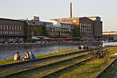 Young people enjoy evening at the Stadthafen at Muenster , Muensterland , North Rhine-Westphalia , Germany , Europe