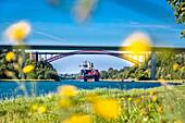 Container ship on the Kiel canal, Kiel, Baltic Coast, Schleswig-Holstein, Germany