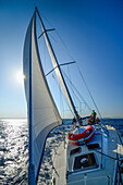 The crew consisting of young women and men sailing a sailing boat along the northern shore of Mallorca, Balearic Islands, Spain, Europe