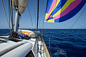 Sailing yacht with Gennaker sail between the Greek Islands, Aegean, Cyclades, Greece