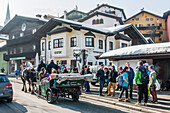 People enjoying a carriage ride through Kitzbuehel, Tyrol, Austria, Europe