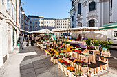 Market and people in the streets of Salzburg, Austria, Europe