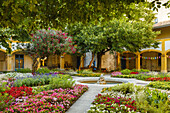 inner courtyard with flowers and fountain, Espace van Gogh, former hospital, image motif of Vincent van Gogh, culture centre, Arles, Bouches-du-Rhone, Provence, France, Europe