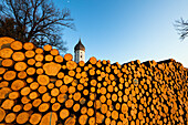 wood piling up in front of a church in Bavaria, Penzberg, Upper Bavaria, Germany