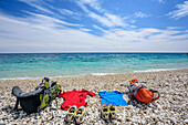 Rucksacks and clothes laying at beach of Cala Sisine at Mediterranean, Cala Sisine, Selvaggio Blu, National Park of the Bay of Orosei and Gennargentu, Sardinia, Italy