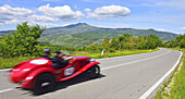 Oldtimer on a road through the Tuscan landscape, Motor Race, Mille Miglia, 1000 Miglia, 2014, Radicofani, Tuscany, Italy, Europe