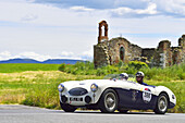 Austin Healey 100 S, 1955, Oldtimer on a road near ruins through the Tuscan valley, Mille Miglia, 1000 Miglia, 2014, San Quirico D´orcia, Siena, Tuscany, Italy, Europe