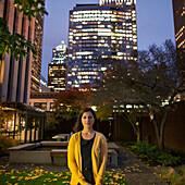Mixed race woman smiling in urban courtyard, Seattle, Washington, USA