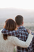 Caucasian couple hugging outdoors, Los Angeles, CA, USA