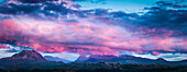Panoramic view of pink clouds over remote landscape, Ullapool, Scotland, UK