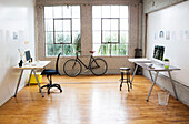 Bicycle and desks in modern office, Los Angeles, California, USA
