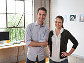 Caucasian architects smiling in office, Los Angeles, California, USA