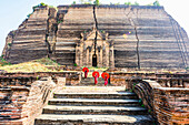 Asian women exploring temple ruins, Mingun, Saigang, Myanmar, Mingun, Saigang, Myanmar