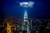 View of city skyline lit up at night, Kuala Lumpur, Malaysia, Kuala Lumpur, Federal Territory of Kuala Lumpur, Malaysia