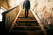 Mari man standing on staircase, Nizhniy Tagil, Sverdlovsk region, Russia