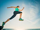 Caucasian woman running on beach, Laguna Beach, California, USA