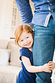 Caucasian girl clutching father's leg, Lehi, Utah, USA