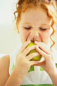 Girl eating apple, Miami, FL, USA
