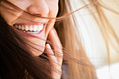 Close up of woman smiling, Jersey City, New Jersey, USA