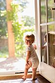 Caucasian toddler standing in doorway, Santa Fe, New Mexico, USA