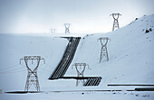 Power lines in snowy arctic landscape, Selfross, Sudhurland, Iceland