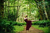 Caucasian woman dancing in forest, C1