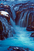 Waterfall flowing over cliff, Bruarfoss, Sudhurland, Iceland, C1