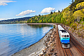 Commuter train on tracks at waterfront, C1