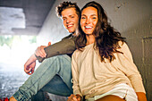 Caucasian couple smiling in tunnel, Seattle, Washington, United States
