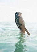 Caucasian woman wading in ocean, Jupiter, Florida, USA