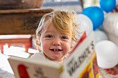 Caucasian baby boy playing with book, Santa Fe, New Mexico, USA